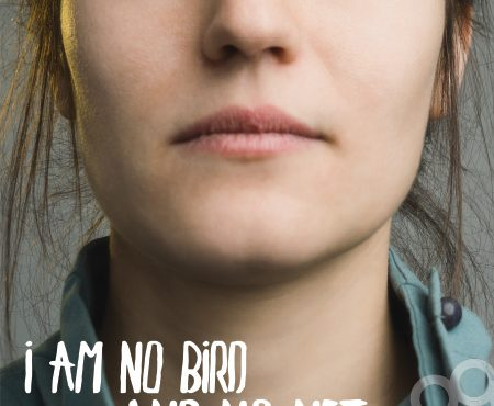 """Resolute young woman gazing directly to camera. Quote text """"I am no bird and no net ensnares me"""" by Charlotte Brontë"""